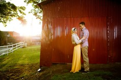muslim engagement photos in the rain by a red barn