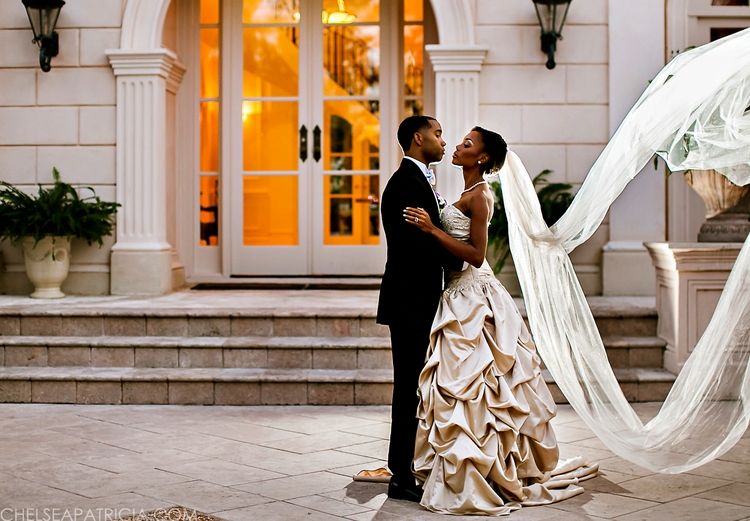 Bride and groom with long veil at Villa Serena in Conyers, GA