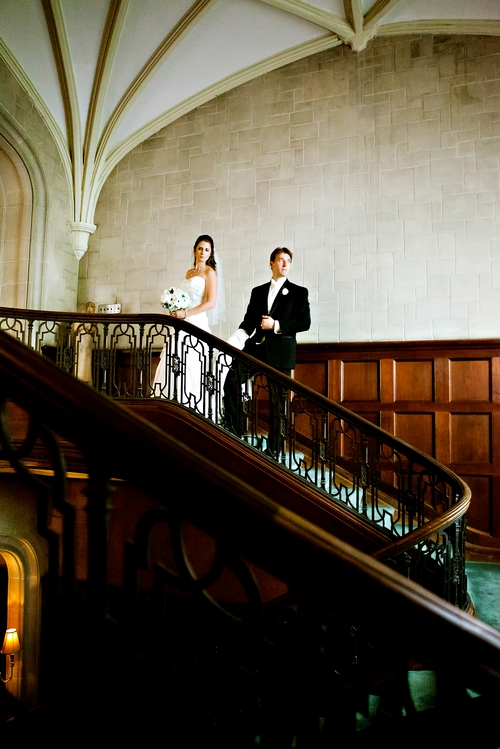 bride and groom on the grand staircase at Callanwolde
