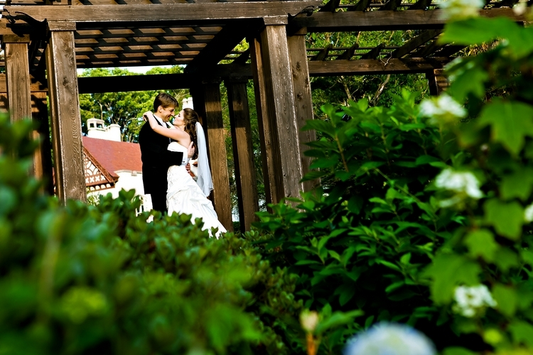 Bride and groom embracing at Callanwolde Fine Arts Center