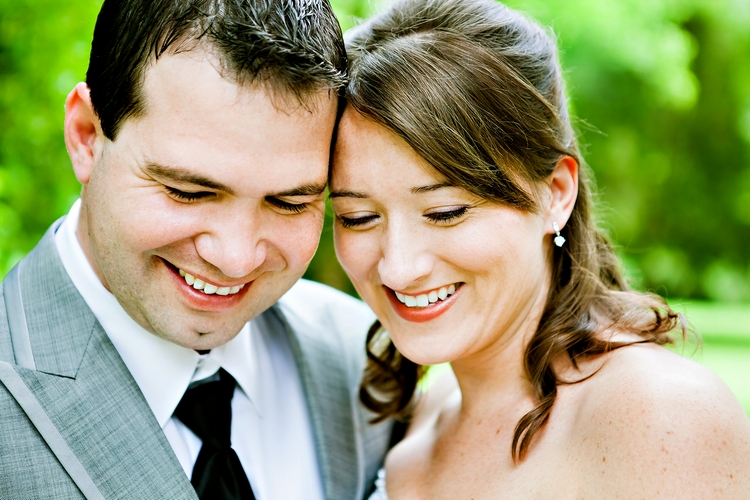 bride and groom laughing at alabama wedding